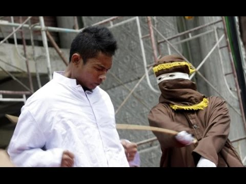"Aceh's caning for ""gay sex"" amounts to torture"