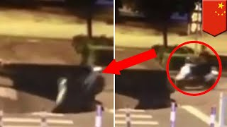 Caught on cam: Scooter rider busy on phone rides scooter straight into a giant sinkhole - TomoNews