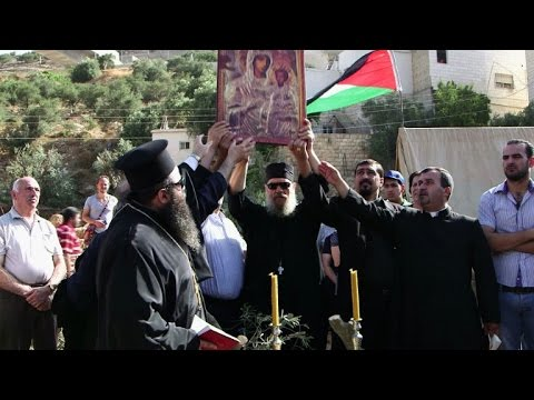 Palestinian Christians protest controversial barrier in the WB