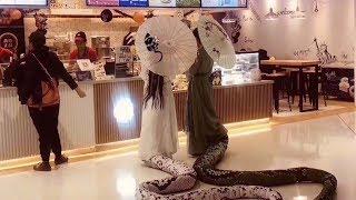 Half snake, half human Halloween costume scares shoppers at Beijing mall