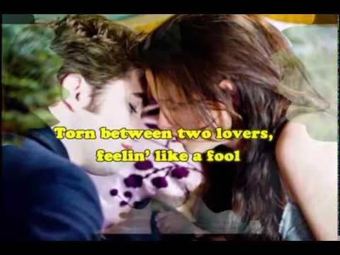 Torn Between Two Lovers Lyrics