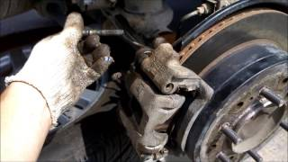 Замена задних колодок Тойота Прадо 150