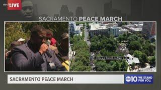 Dr Tecoy Porter leads prayer for change at Sacramento Peace March
