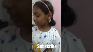 10 years old girl making chocolate cake at home