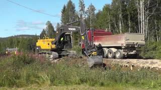 Volvo EC250DNL Loading Gravel On To A Volvo FH12 460 8x4