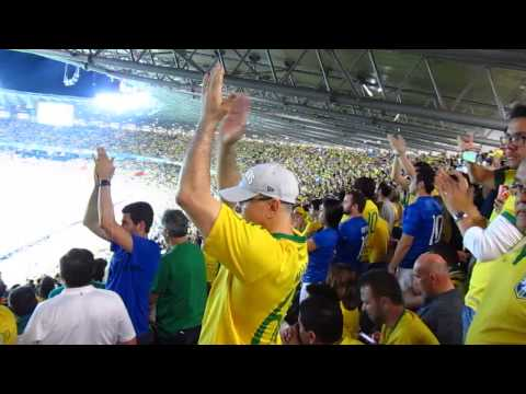 Brazilian supporters applause after the seventh German goal