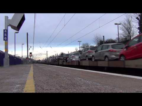 (HD) 67026 & 67022 Pass Ealing Broadway With Car Transporters Train