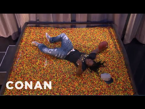 Marshawn Lynch Dives Into An End Zone Of Skittles  - CONAN on TBS
