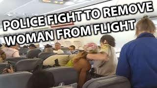 Police Fight to Remove Disruptive Woman off Spirit Airlines Flight