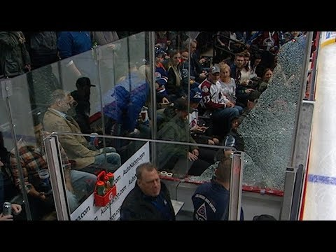 Excited fan accidentally shatters glass in Penalty Box