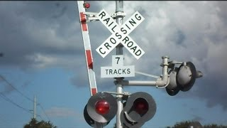 CSX Train Goes Through Railroad Crossing With 7 Tracks