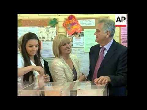 WRAP Polls open in Serbian general election ADDS Nikolic, Tadic voting