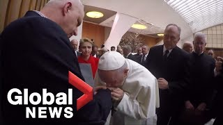 Pope Francis kisses hand of Polish sex abuse survivor during Vatican conference on issue