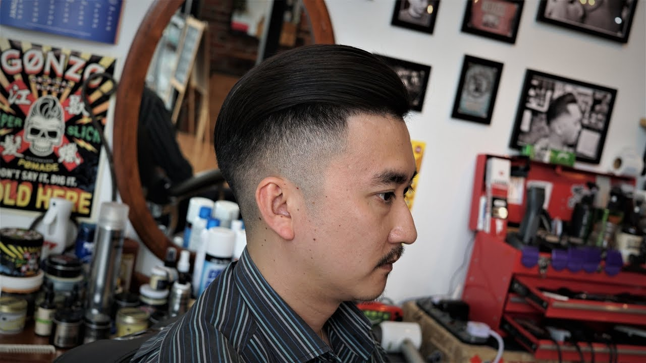 Mens Skin Fade Slick Back With Hard Part Haircut Loose Pompadour