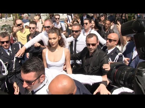 Crazy arrival for Bella Hadid at the Magnum Beach in Cannes