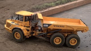 RC Cat Dumpers in Action! Nice realistic Dump Trucks at work.