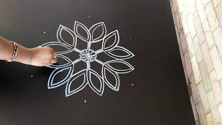 Simple 7 to 4 dotted freehand design...diyaas..Easy rangoli design..