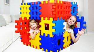 kids pretend playing with colored toy blocks