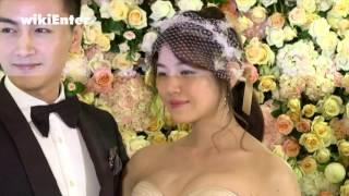 手牽著手、面對面深情擁吻,曉希夫婦陳曉和陳妍希一結束在北京的婚禮,...