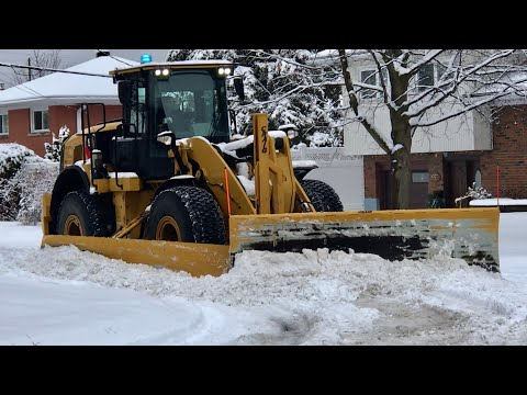 Snow Removal CAT Loader Plowing Heavy Snow