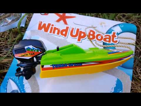 wind up toy boats with outboard motors in pool