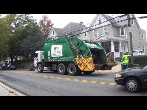 Waste Management Garbage Truck Is Picking Up Some Trash