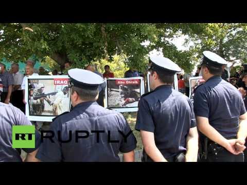 Georgia: Anti-NATO protesters stand off against vast police cordon