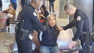 Part 1  LAX airport police on a woman claims a pilot gave her a bag at  LAX
