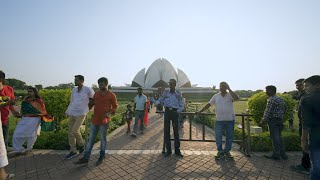 Time lapse of people walking in and out of Lotus Temple