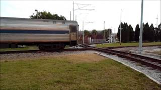 Amtrak Train 92 And Trolley Cars
