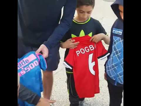 ROBBIE LAWLOR GIVING AWAY FOOTBALL TOPS TO KIDS