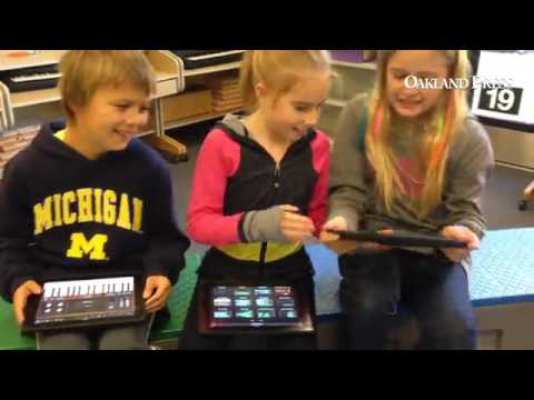 Kids taking part in a music class using iPads at  Webber Elementary School in Orion Township.