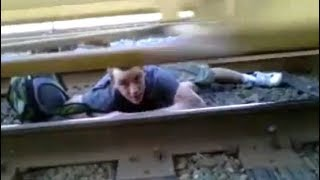 Guy Lays Under Moving Train In India