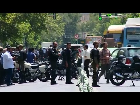 ISIS-claimed attacks on Iranian parliament and shrine kill at least 12