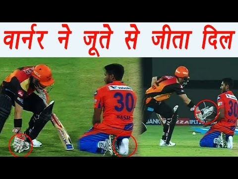 IPL 2017: David Warner picks up Basil Thampi's shoe during Hyderabad vs Gujarat    वनइंडिया हिन्दी