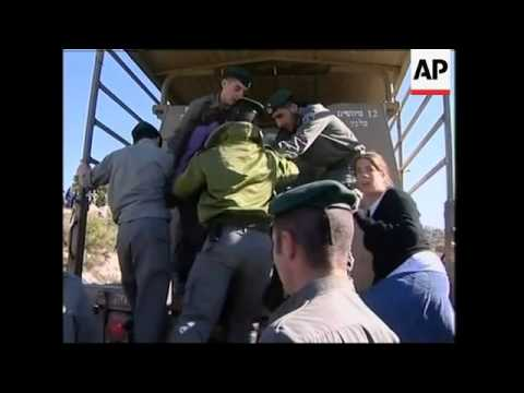 Israeli soldiers dismantle two small illegal settlement outposts