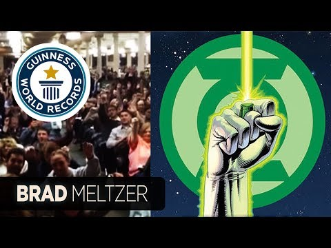Brad Meltzer breaks Guinness Record while doing Green Lantern Oath with decoder rings