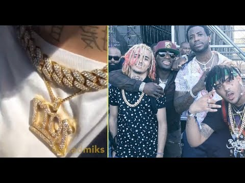 Lil Pump rocks a '1017' Chain after meeting with Gucci Mane about signing to his label.