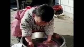Baby helping sick Mother in housework