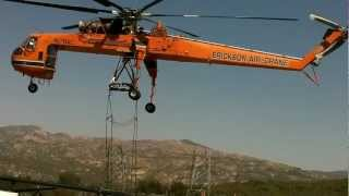 Aircrane Lifting A Bridge of a high line transmission lattice tower