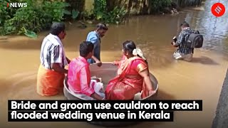 Bride and groom use cauldron to reach flooded wedding venue in Kerala