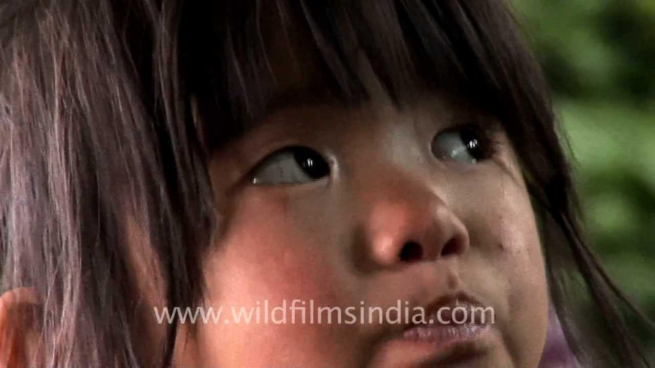 Cute little Naga girl selling live worms, Kohima