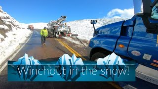 Winching out a big rig in the snow