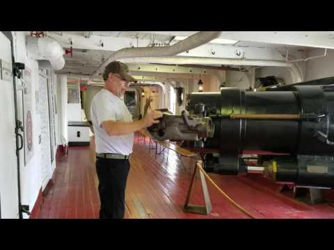 "USS OLYMPIA,OPENING 5"" GUN BREACH"