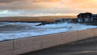 Highest tides for 20 years and storm waves hit Westward Ho! sea front and pebble ridge.