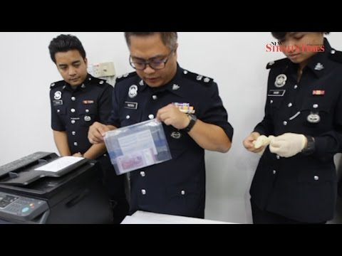 Kuching cops cripple fake money syndicate headed by 16-year-old