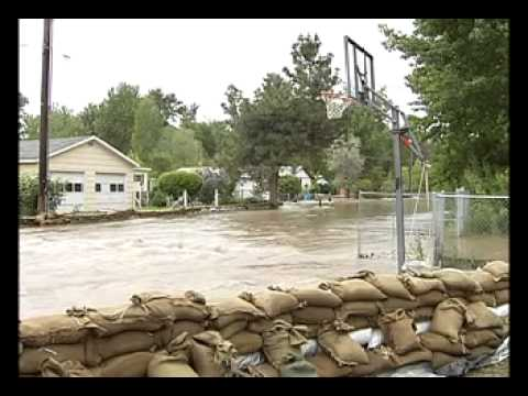 Missoula homes surrounded by moving water