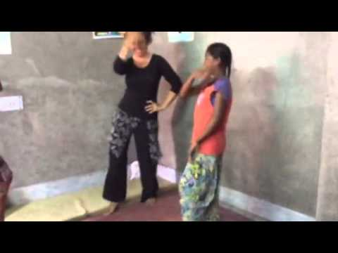 Preparation of event in slum school,girls dancing with volunteer Nichole