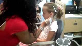 Skylar getting earrings - tough kid.
