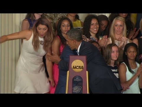 Obama helps UConn player who fell off stage
